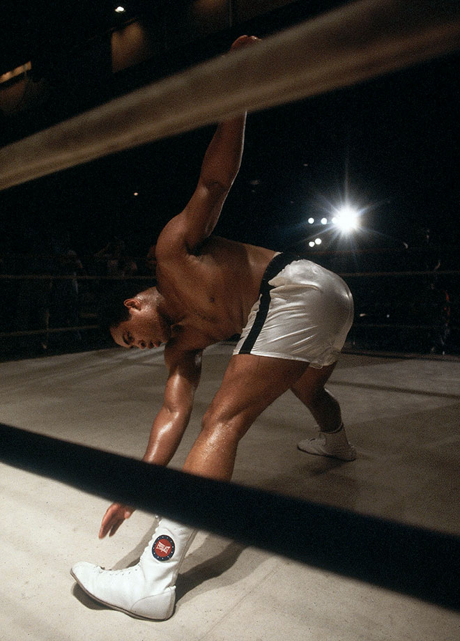Ignoring pleas for his retirement, Ali stretches before a fight against Trevor Berbick in Nassau, Bahamas. Ali lost to Berbick in a unanimous decision and retired after the bout, the 61st of his career.