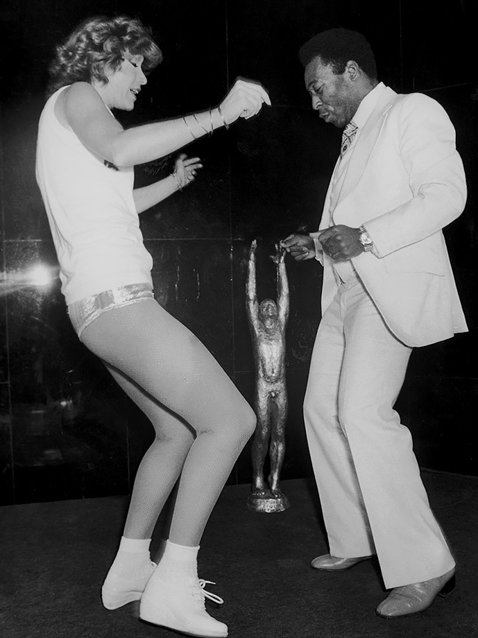 Pelé shows off his moves after his team beat France in 1981. His moves on the pitch dazzled as well, as he was renowned for his brilliant dribbling skills.