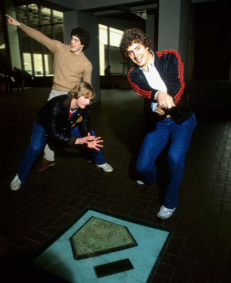 Dan Marino and friends pose with the Forbes Field home plate at Posvar Hall at the University of Pittsburgh on April 10, 1982.