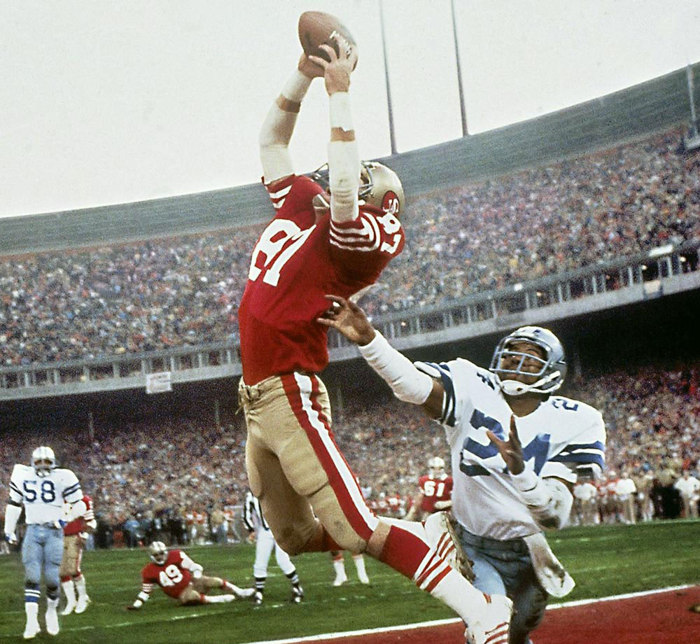 "On a third-and-3 at the Dallas six with 58 seconds to go, with San Francisco down by six points, Joe Montana drifted out of the pocket, drifted right, drifted in a bit of a backpedal, drifted until he could drift no more. Then he lofted a pass toward the end zone, high and seemingly uncatchable. Until Dwight Clark leaped up near the end line and made ""The Catch."""