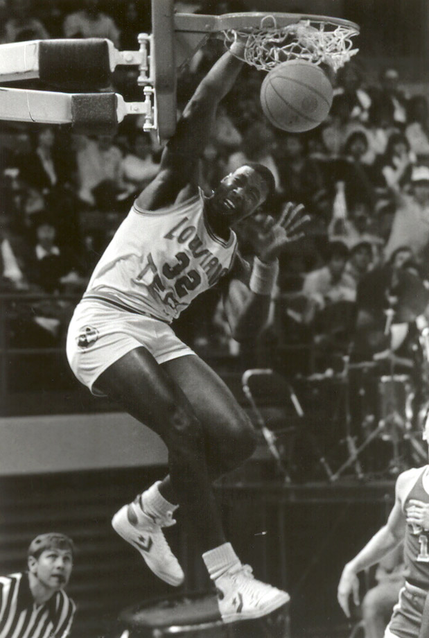 Karl Malone dunks during a Louisiana Tech University Bulldogs game at Thomas Assembly Center in Ruston, La.