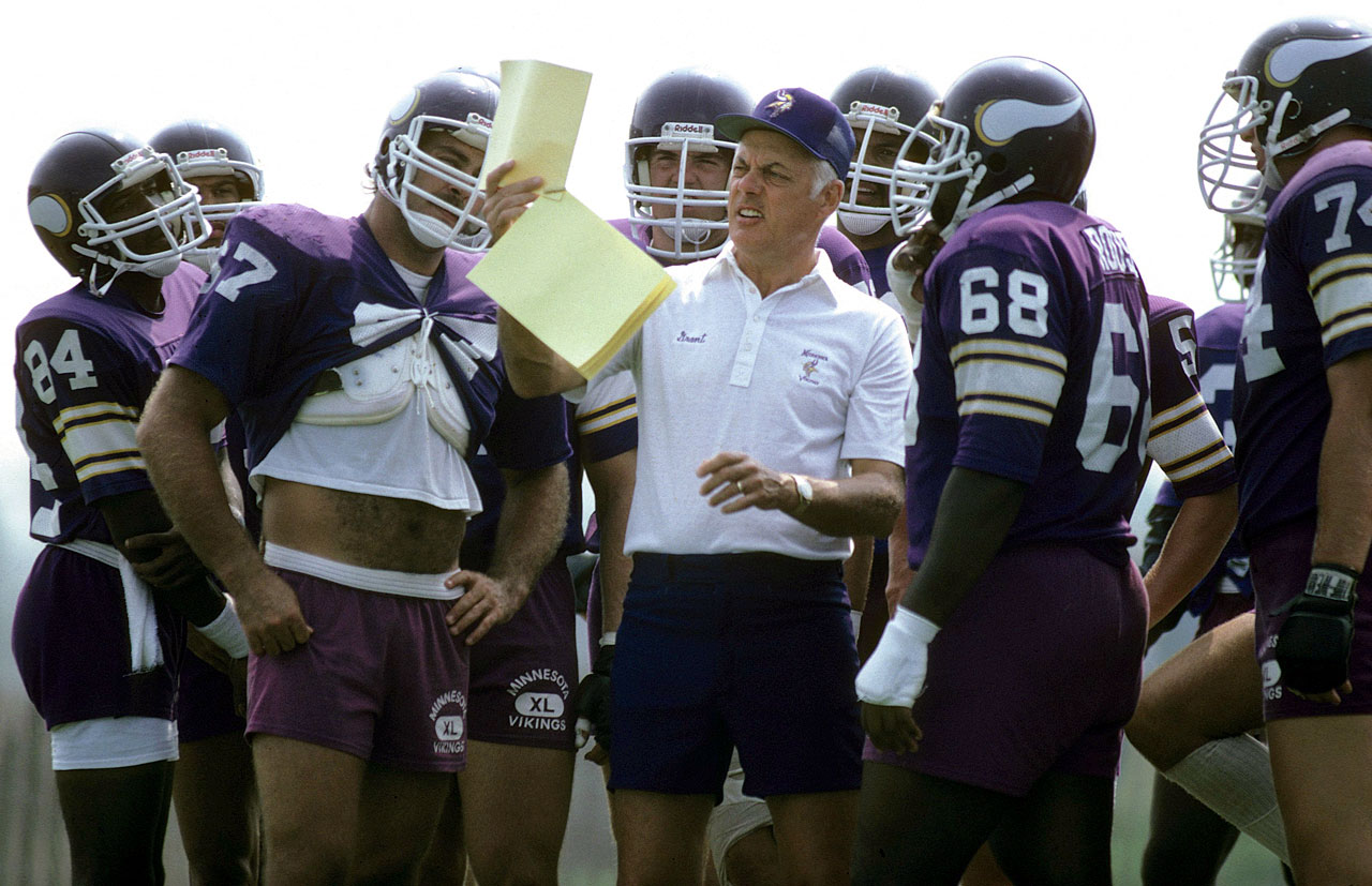 Vikings head coach Bud Grant reviews a play with his offense during training camp in Mankato, Minn.