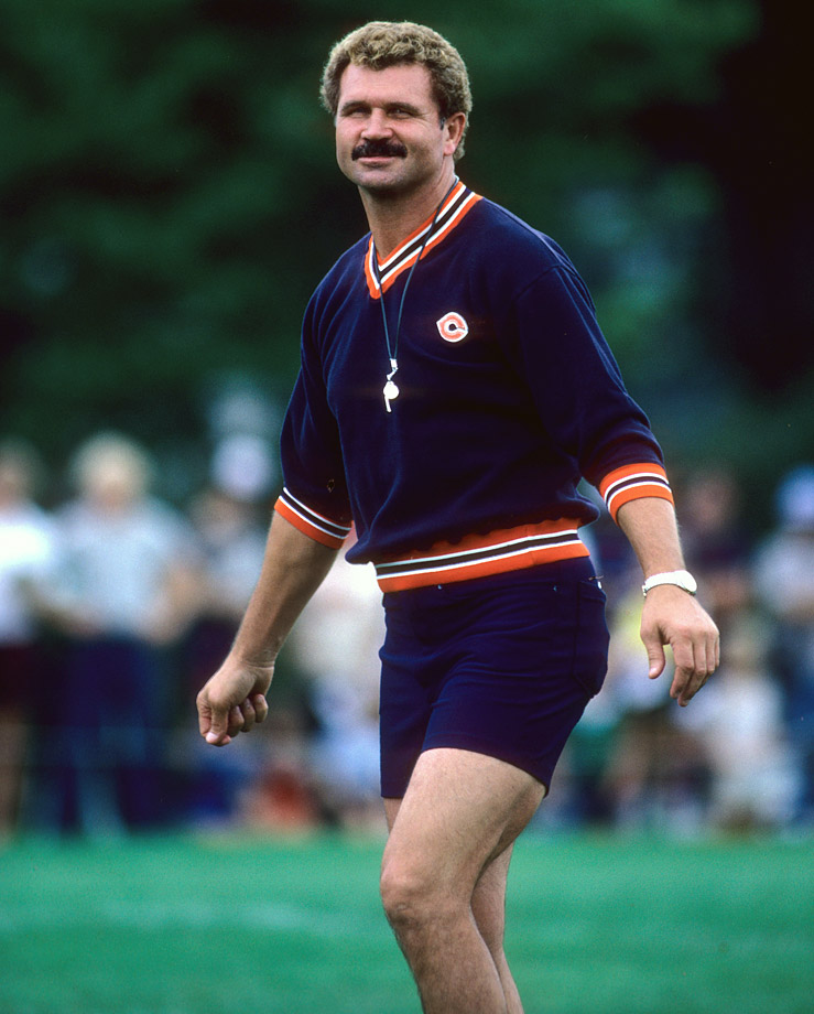 The Bears' new head coach Mike Ditka smiles during training camp at Lake Forest College in Lake Forest, Ill.