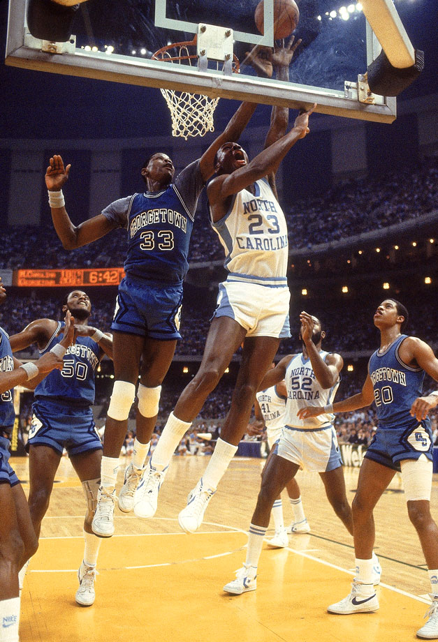 Michael Jordan goes for a layup against Patrick Ewing during the 1982 NCAA National Championship between North Carolina and Georgetown.