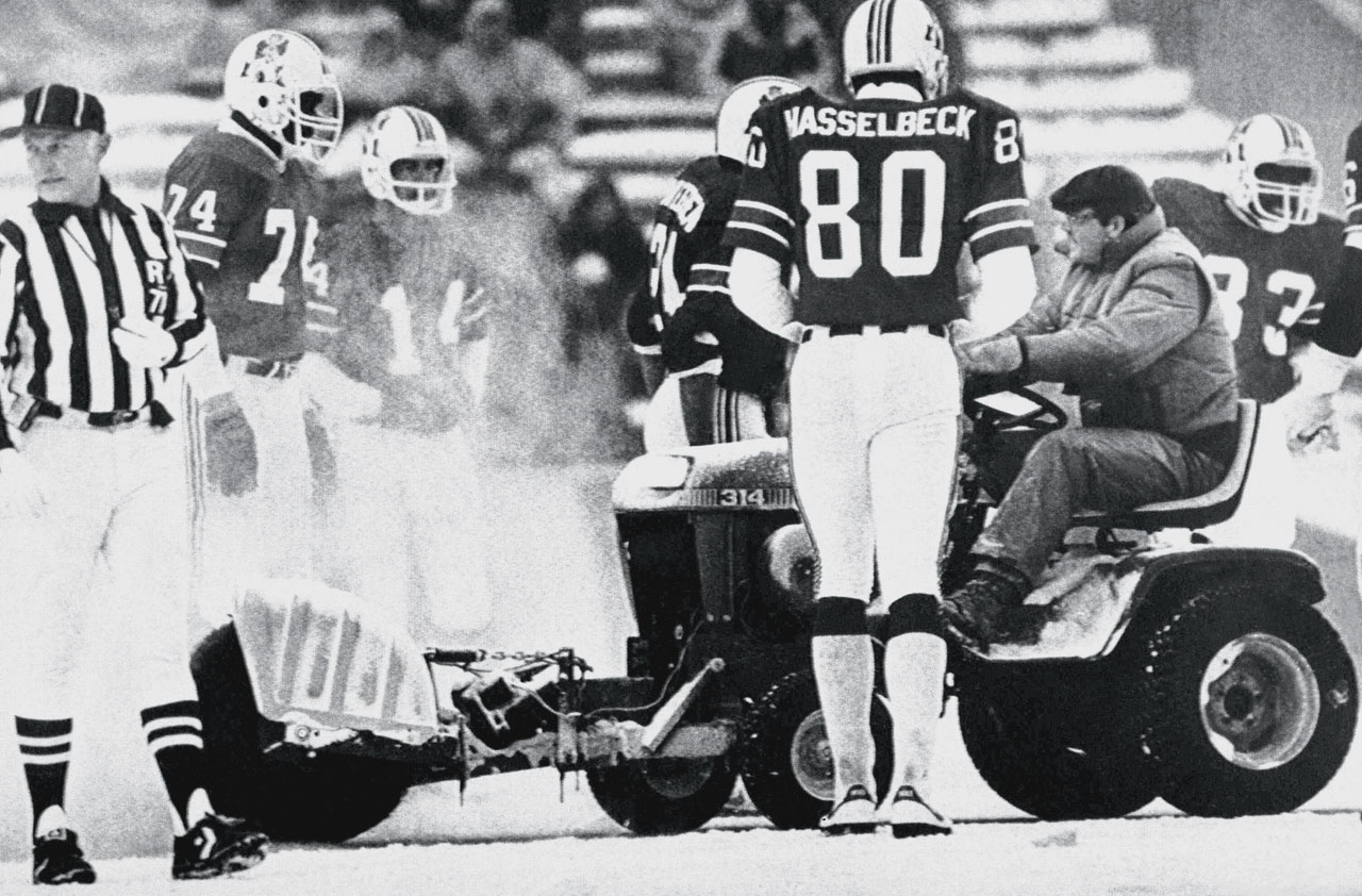 "Patriots kicker John Smith converted the game-winning 33-yard field goal after New England head coach Ron Meyer and quarterback Steve Grogan waved snow plow driver Mark Henderson -- a convict out on a work-release program -- onto the field to clear a spot for Smith's kick.  Miami coach Don Shula protested furiously but the field goal was good and the Patriots won the now infamous ""Snow Plow Game"" 3–0."