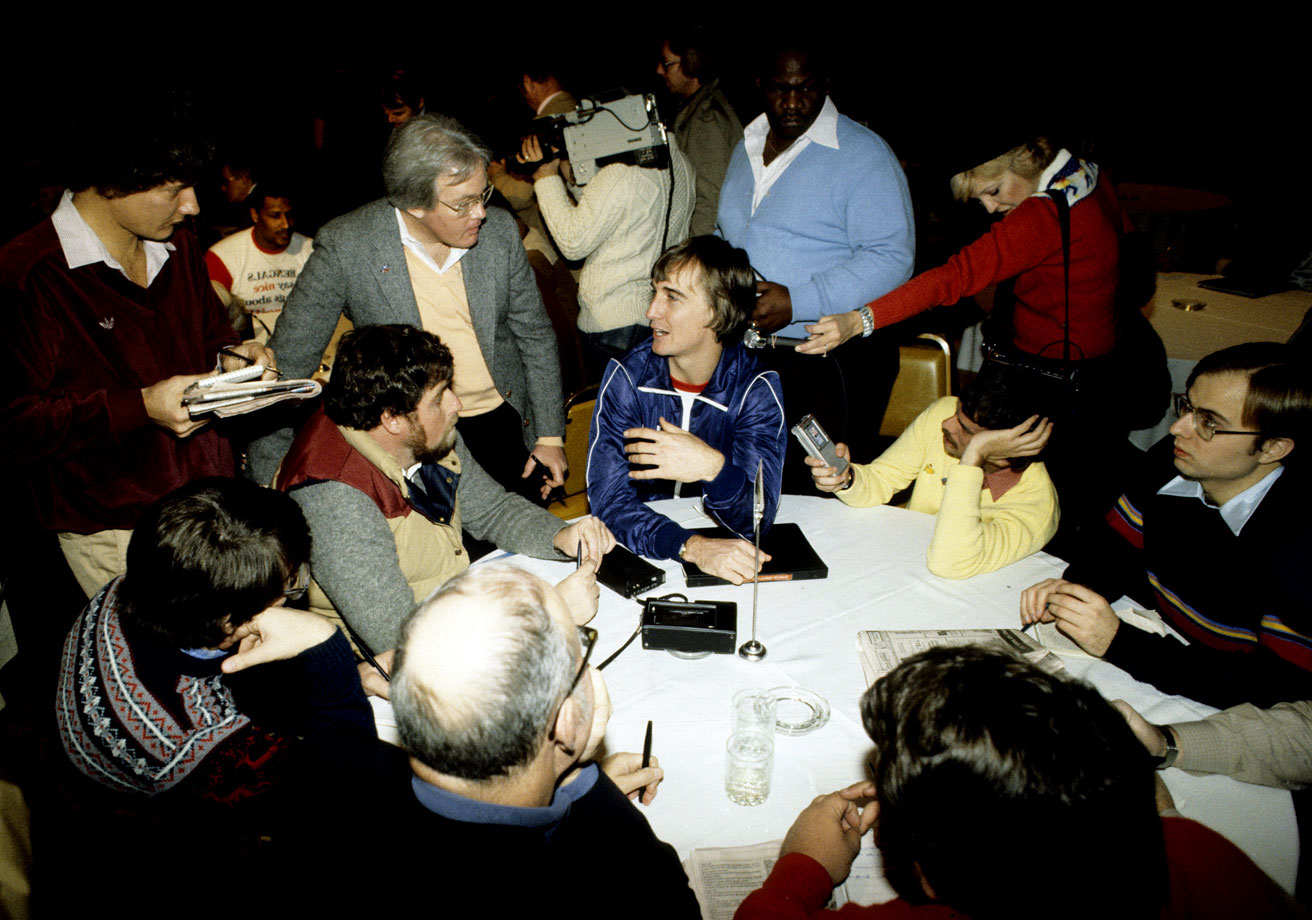 Bengals rookie Cris Collinsworth answers questions before Super Bowl XVI. The wide receiver would go on to catch five passes for 107 yards in a losing effort.