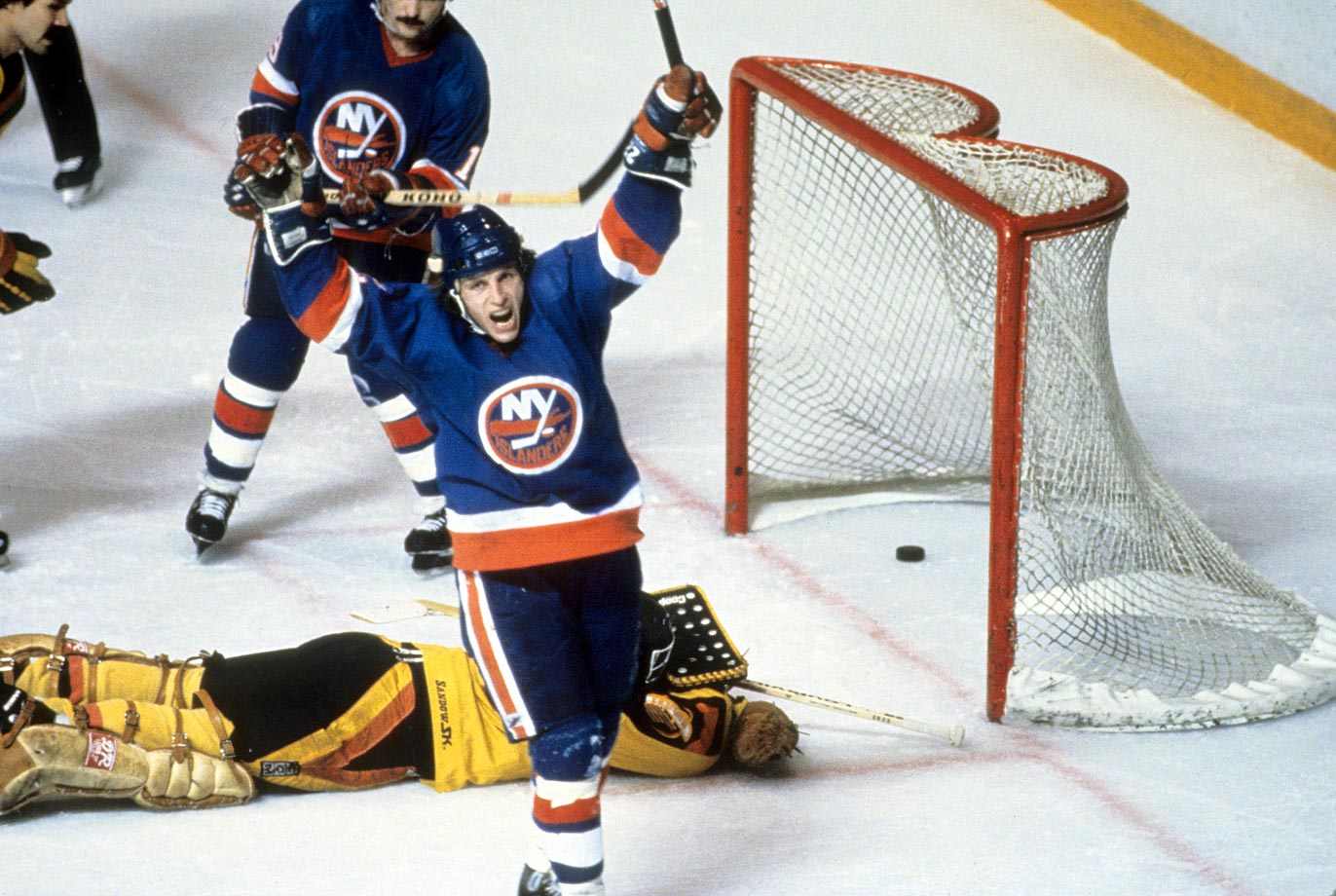 The Hall of Fame sniper, who racked up 64 goals during the regular season and 17 more in the playoffs, terrorized the Canucks with seven in the Islanders' sweep of the series. Here, the 1982 playoff MVP exults after beating Vancouver goalie Richard Brodeur for one of his two power play tallies in the Isles' 3-1 win in Game 4 that made them the first U.S.-based team to win three consecutive Stanley Cups.