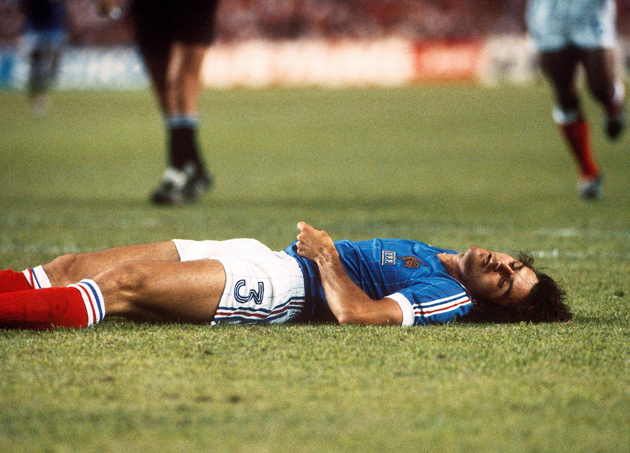 Frenchman Patrick Battiston lies unconscious, sporting a broken jaw and missing two teeth after being on the receiving end of a body check from West German goalkeeper Harald Schumacher during the countries' semifinal matchup in the 1982 World Cup.
