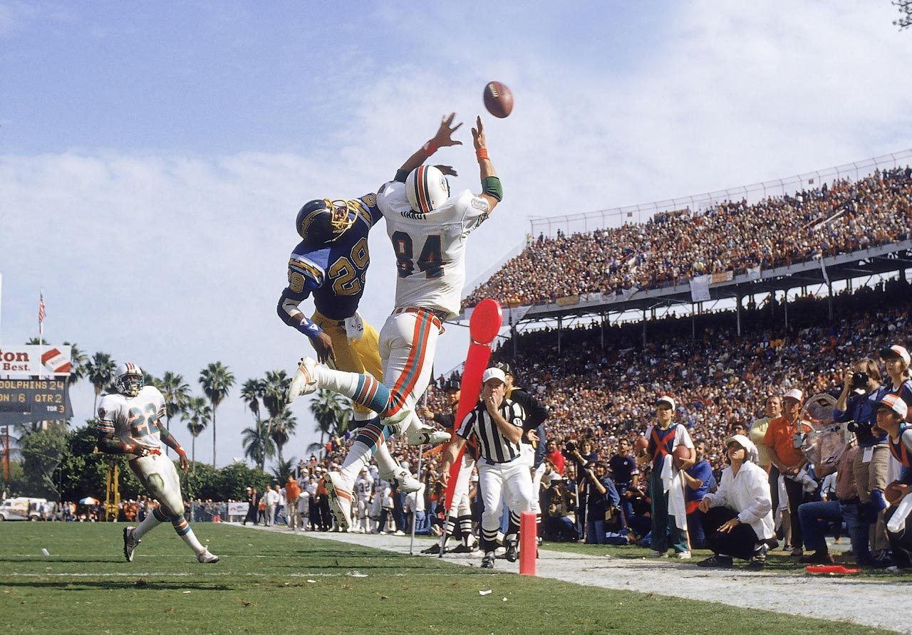 The Chargers' Mike Williams got up high to cover Dolphins tight end Bruce Hardy, who went even higher for this catch.