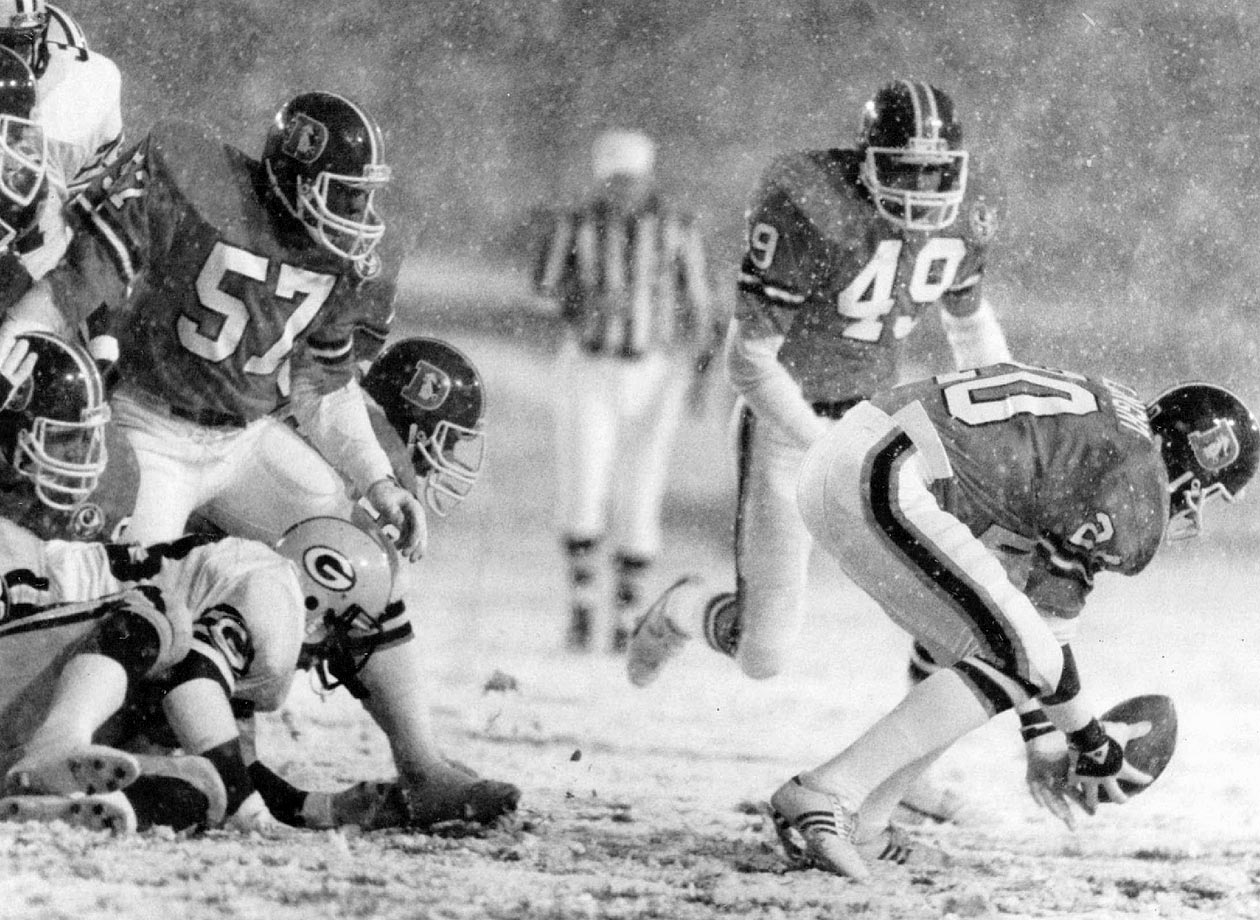 "An early season snowstorm in Denver caused the Packers to fumble on their first two plays from scrimmage. Both fumbles were returned for Broncos touchdowns in what is still the only time in NFL history a defense scored twice on the first two plays from scrimmage. Up 14-0 with 14:23 still left in the opening quarter, Denver could only muster a field goal despite three more Green Bay turnovers but held on to win 17-14 in the ""Bronco Blizzard."""