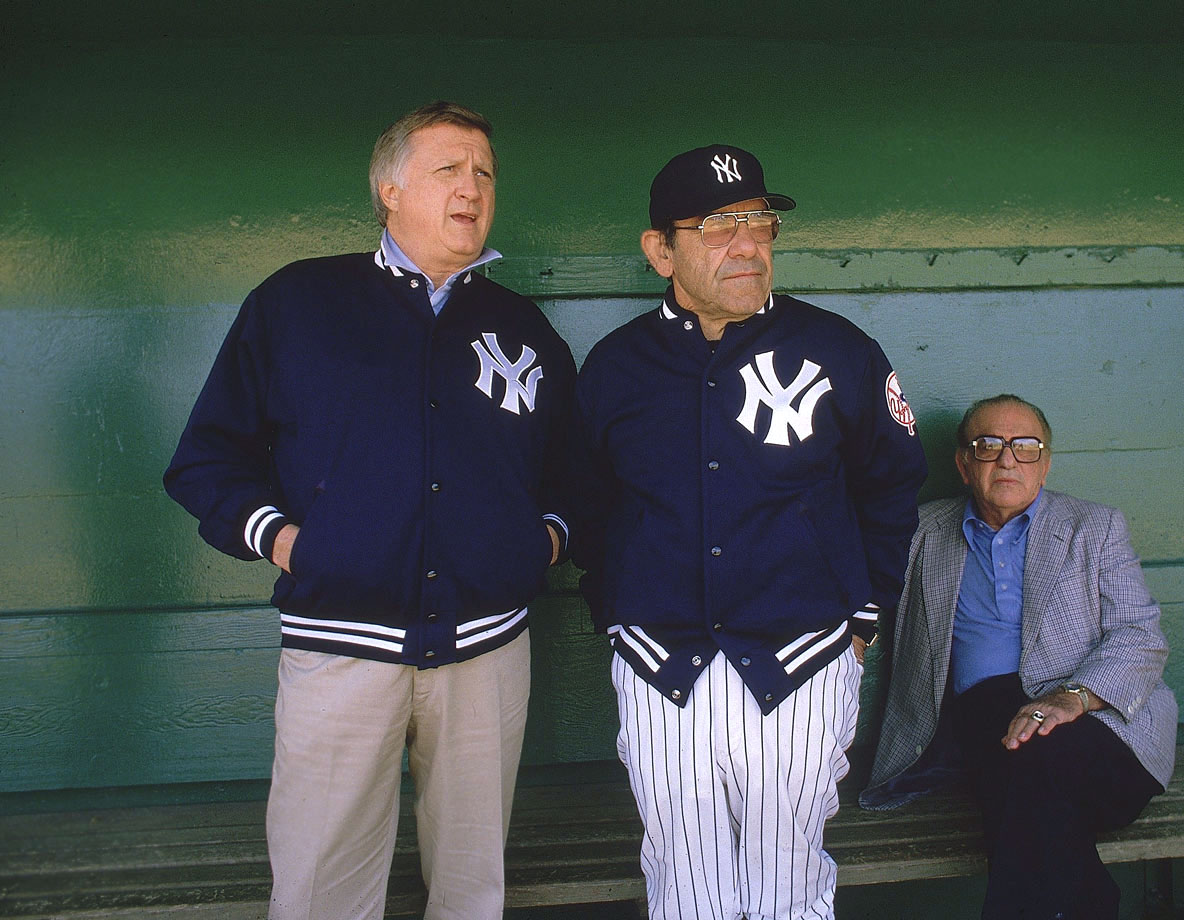 George Steinbrenner stands alongside New York Yankees manager Yogi Berra in 1984.