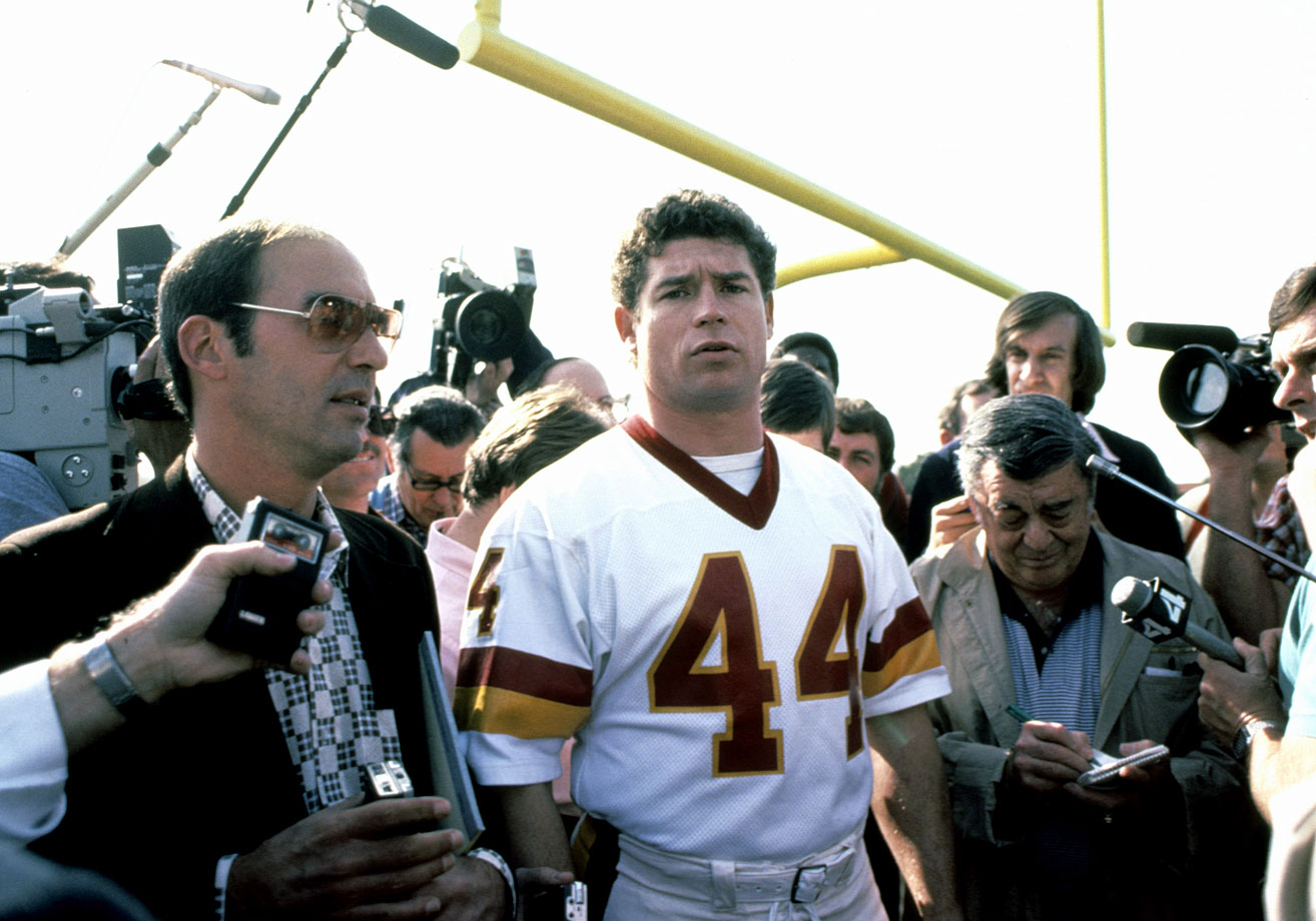 The media attempts to talk with Redskins running back John Riggins at Super Bowl XVIII Media Day in Tampa. The game turned into a nightmare for Riggins and his teammates, who lost to the Raiders, 38-9.