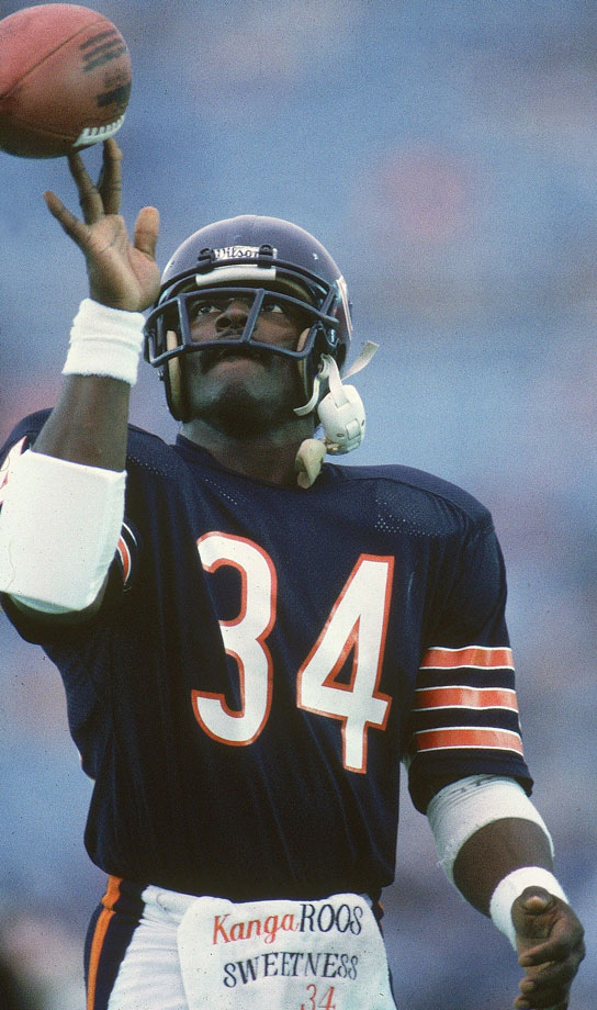 Walter Payton twirls the ball on his fingertips during a game against the New Orleans Saints on Oct. 7, 1984. Payton broke Jim Brown's rushing record during the game.