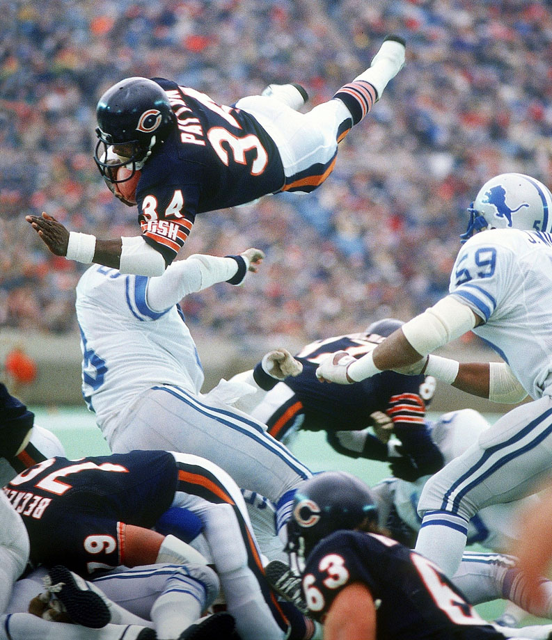 Walter Payton lunges over defenders for a first down against the Detroit Lions on Nov. 18, 1984.