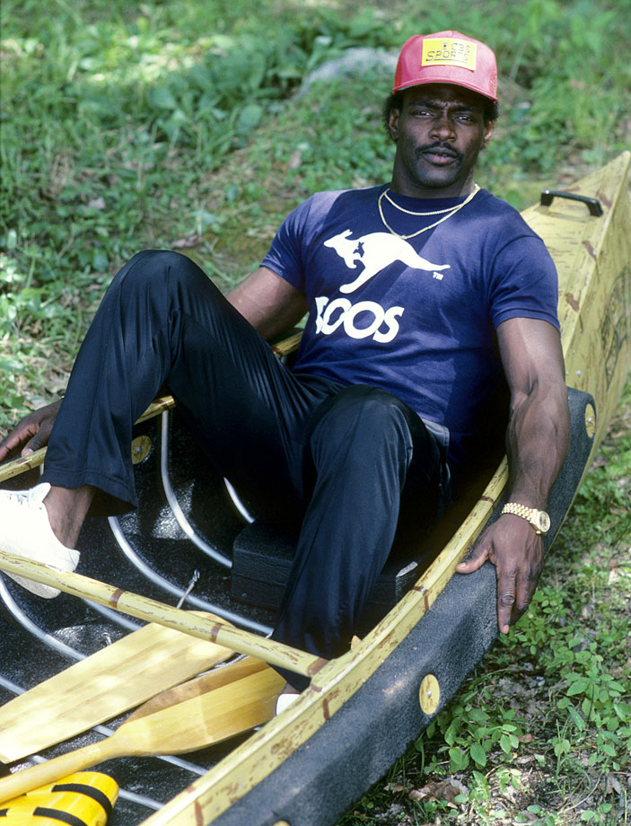 Walter Payton sits alone in a canoe on July 3, 1984 in Lake Forest, Ill.