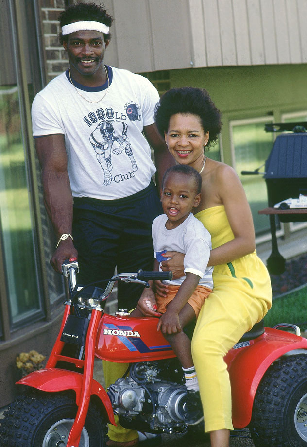 Walter Payton poses with his wife Connie and son Jarrett at their home in Chicago on June 12, 1984.