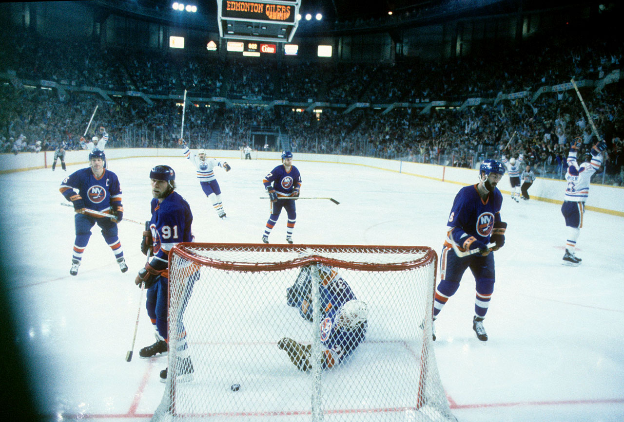 New York's dynasty stalwarts (left to right) Denis Potvin, Butch Goring, Greg Gilbert, Billy Smith and Ken Morrow experienced that sinking feeling after giving up a goal against the rising powerhouse Oilers at Northlands Coliseum in Edmonton. Wayne Gretzky's team rolled to the Cup in five games.
