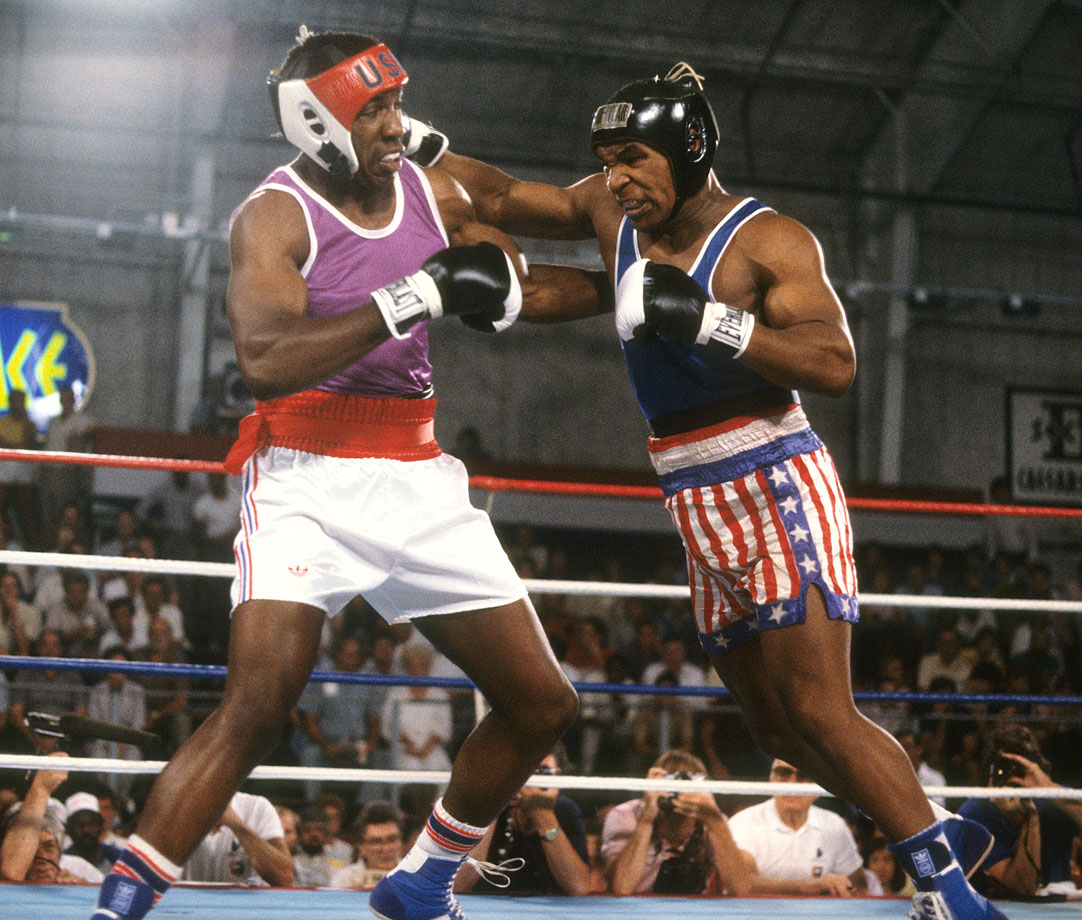 Mike Tyson lands a blow to Henry Tillman during their Heavyweight bout at the U.S. Olympic Trials held at the Sports Pavilion of Caesars Palace in Las Vegas.