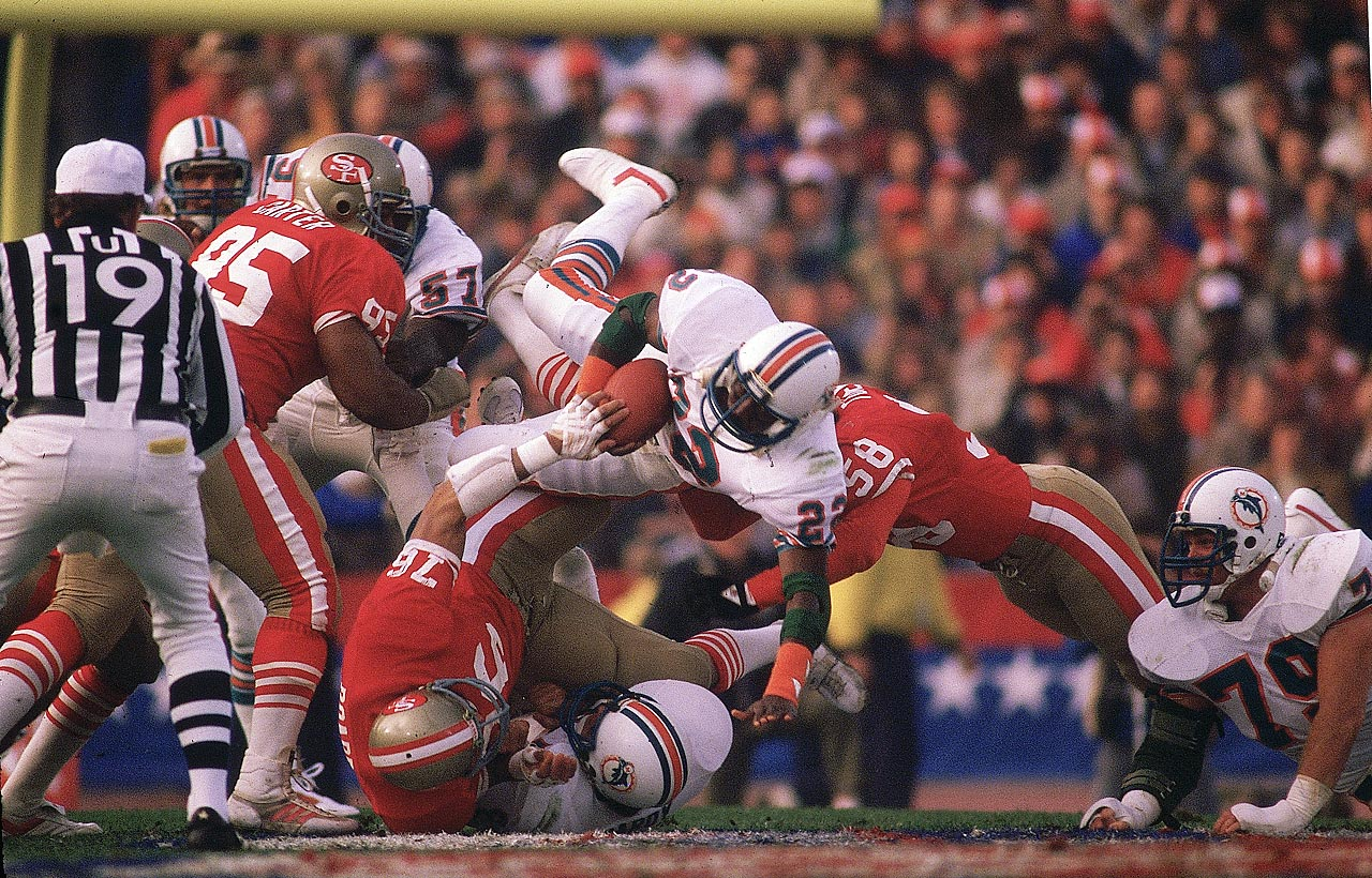 Miami Dolphins running back Tony Nathan dives on top of the San Francisco 49ers defense. Nathan had limited success running the ball in the 38-16 loss, gaining just 18 yards on the ground. He did pick up 83 receiving yards on 10 catches.