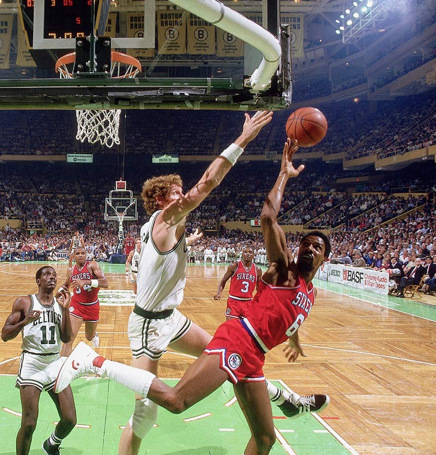 Bill Walton and Dr. J go at it during a preseason game in 1985.