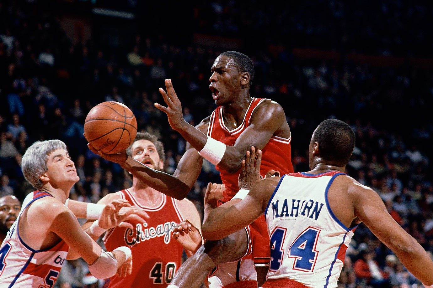 Michael Jordan tries to drive through traffic against Washington in January 1985. After averaging 28.2 points, 6.5 rebounds, 5.9 assists and 2.4 steals, Jordan was named Rookie of the Year and selected for the All-Star Game, the first of his 14 selections.