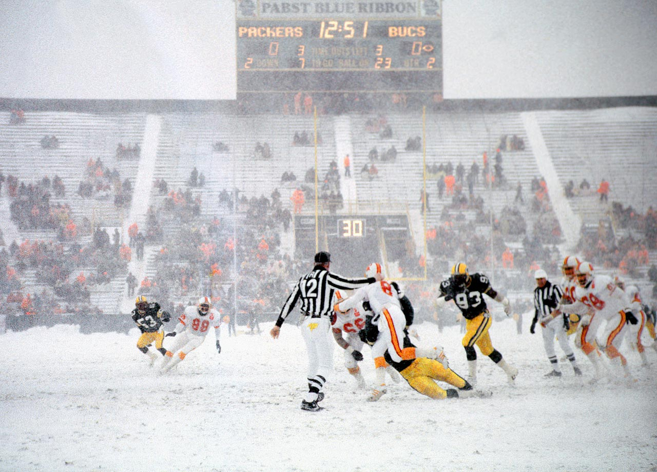 "A 16-inch snowfall blanketed Green Bay, and many fans drove their snowmobiles to the stadium.  About 2/3 of the Lambeau Field was empty for the ""Snow Bowl.""  Despite four turnovers, the Packers offense gained 512 total yards on 31 first downs en route to a 21-0 win, with the Buccaneers recording only 65 yards on 5 first downs."