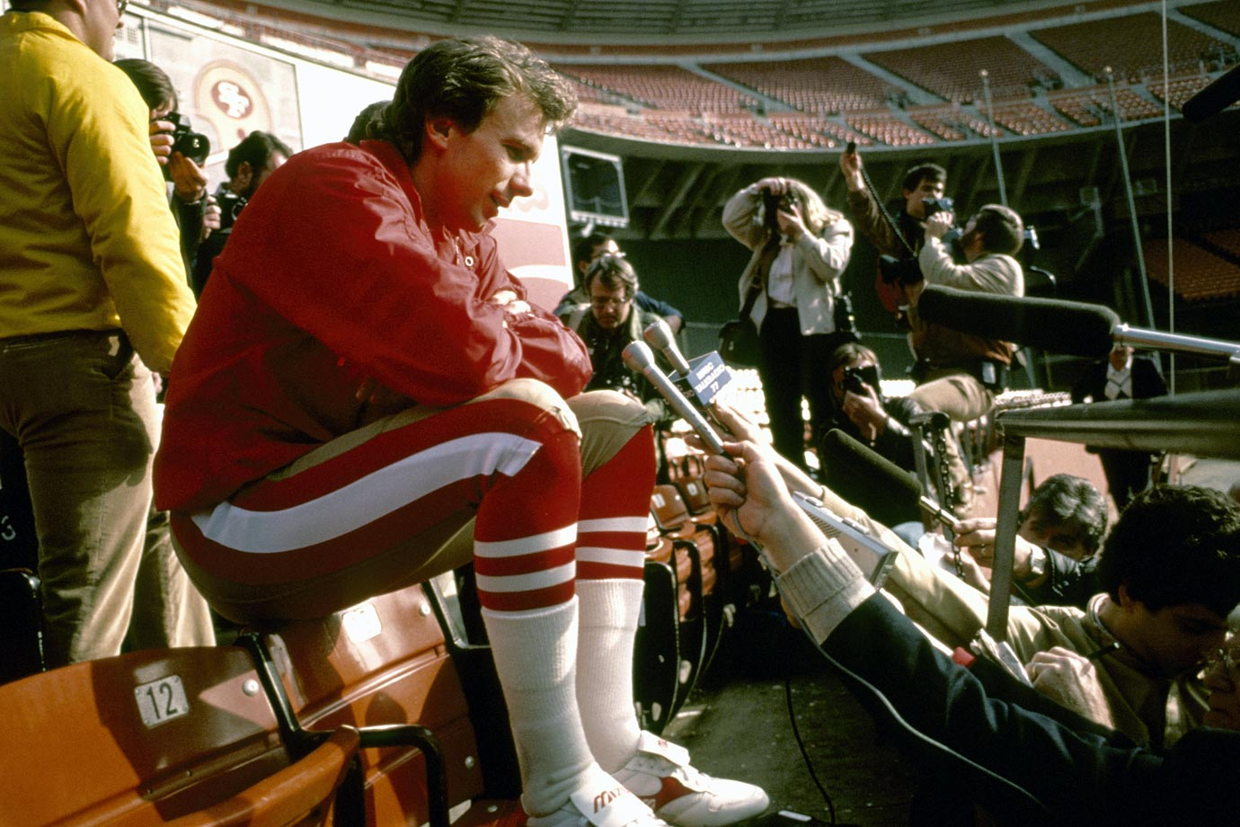 Joe Montana answers questions at Super Bowl XIX Media Day at Stanford Stadium. The 49ers defeated the Dolphins 38-16, led by Montana's 331 passing yards and three touchdowns.