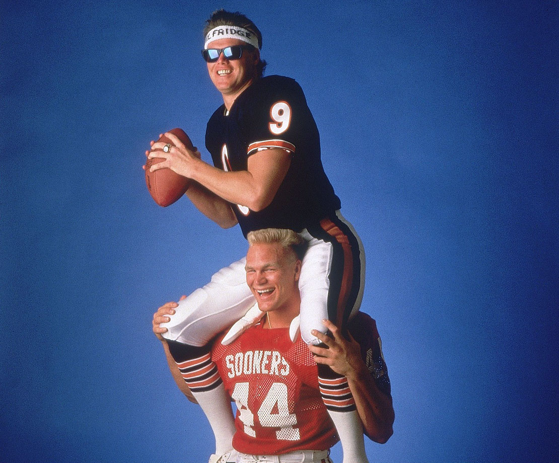 Bosworth carries Chicago Bears quaterback Jim McMahon on his shoulders during an SI photo shoot.