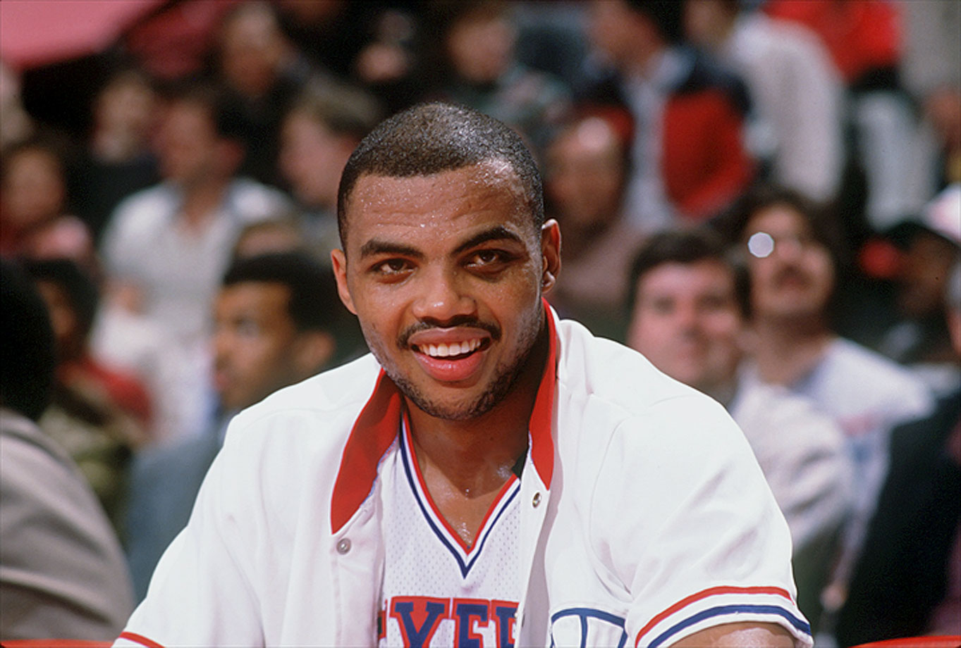 Charles Barkley smiles on the bench during a game against the Portland Trail Blazers.