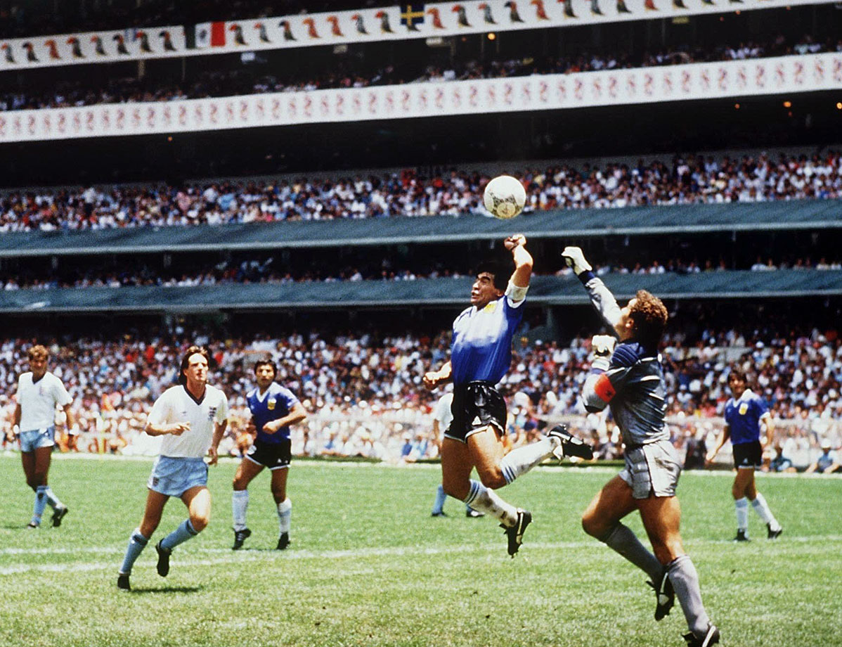 "Diego Maradona punches in the infamous ""Hand of God"" goal against England in the 1986 World Cup."