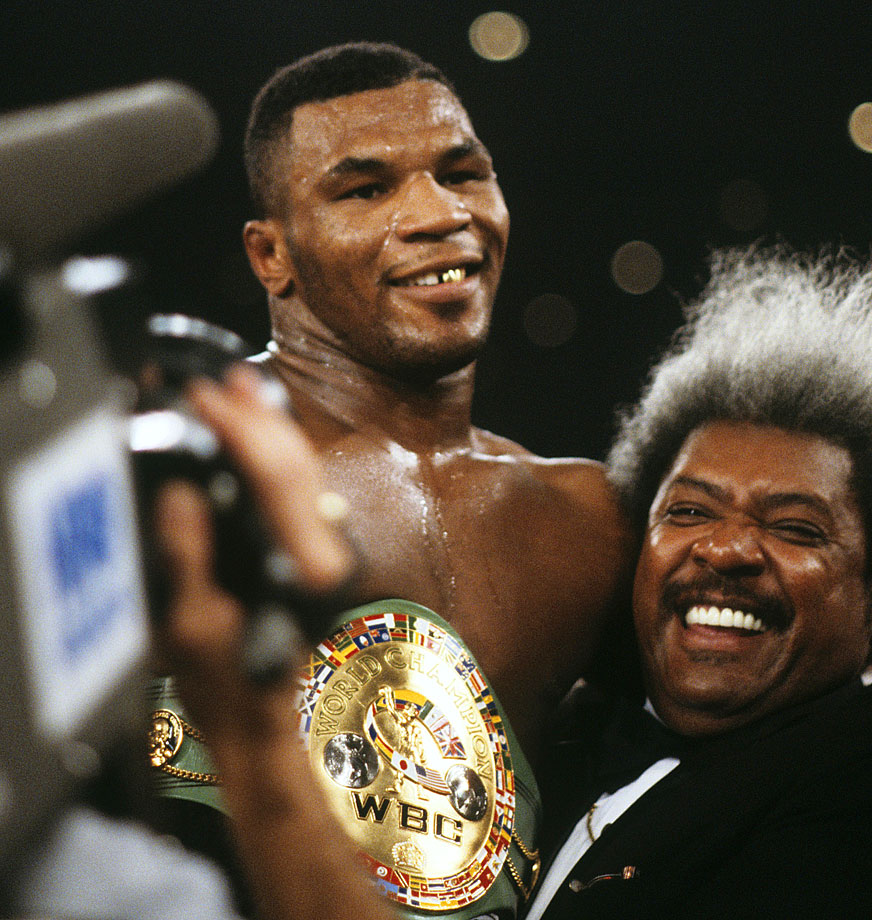 Mike Tyson was all smiles after winning the WBC title with a second round TKO of Trevor Berbick.  Longtime promoter Don King and Tyson were once a winning combination.