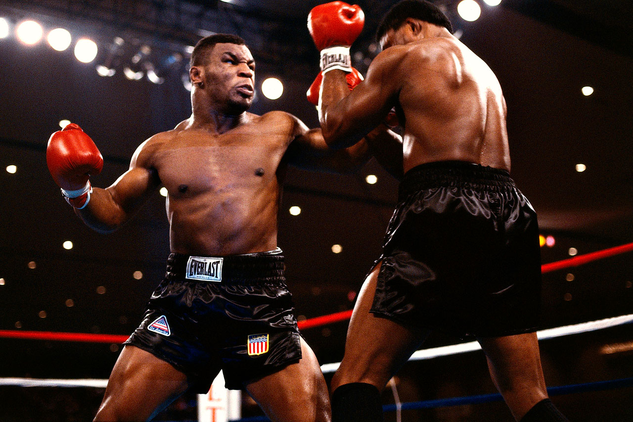 Boxing was re-energized in the 1980's by the emergence of the seemingly unstoppable Tyson, who tore through the heavweight ranks with a fearsome blend of speed and power. Here, he unloads on WBC champion Berbick at the Las Vegas Hilton on Nov. 11, 1986. Tyson would end the bout with a stunning 2nd round TKO to become the youngest heavyweight champion in history.