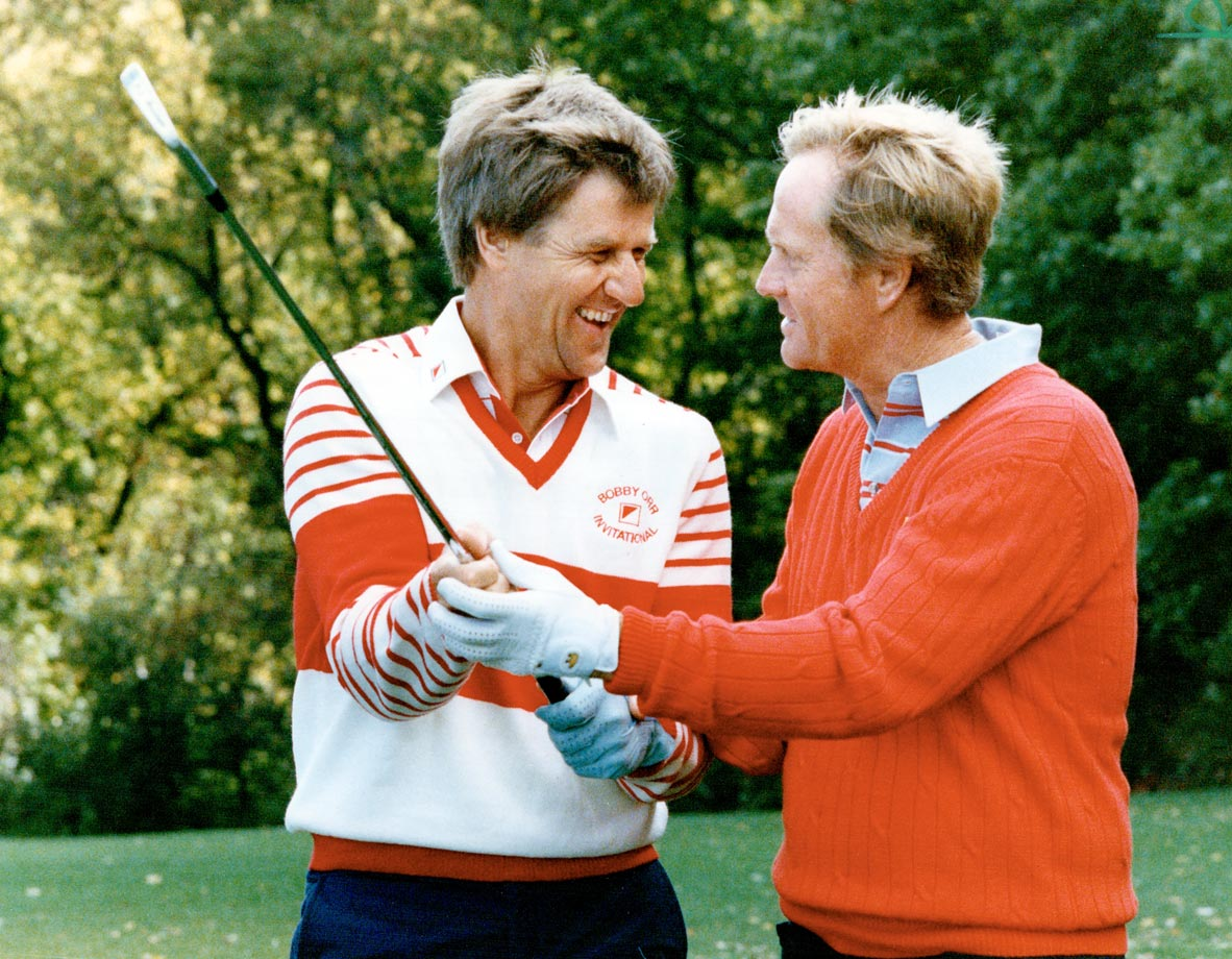 Golfing great Jack Nicklaus gives Orr some tips at the Bobby Orr Invitational golf tournament at Emerald Hills in 1987.