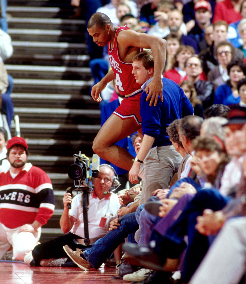 Charles Barkley pats a fan on the back after diving into the stands during a game against the Portland Trail Blazers. Barkley posted a career-high scoring average with 28.3 points per game in the 1987-88 season, including 37 points in this loss to the Trail Blazers.