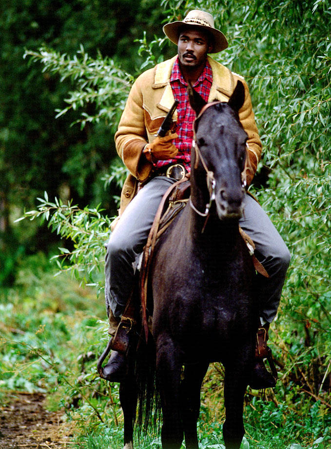 Karl Malone rides a horse during the shooting of a commercial in Utah.