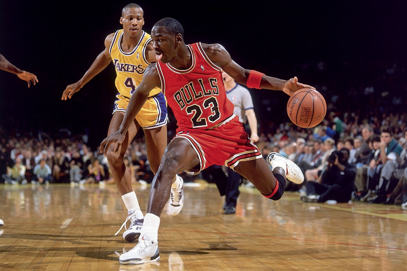 fe7c256275c Michael Jordan fakes on a drive against the Los Angeles Lakers in February  1988. Jordan