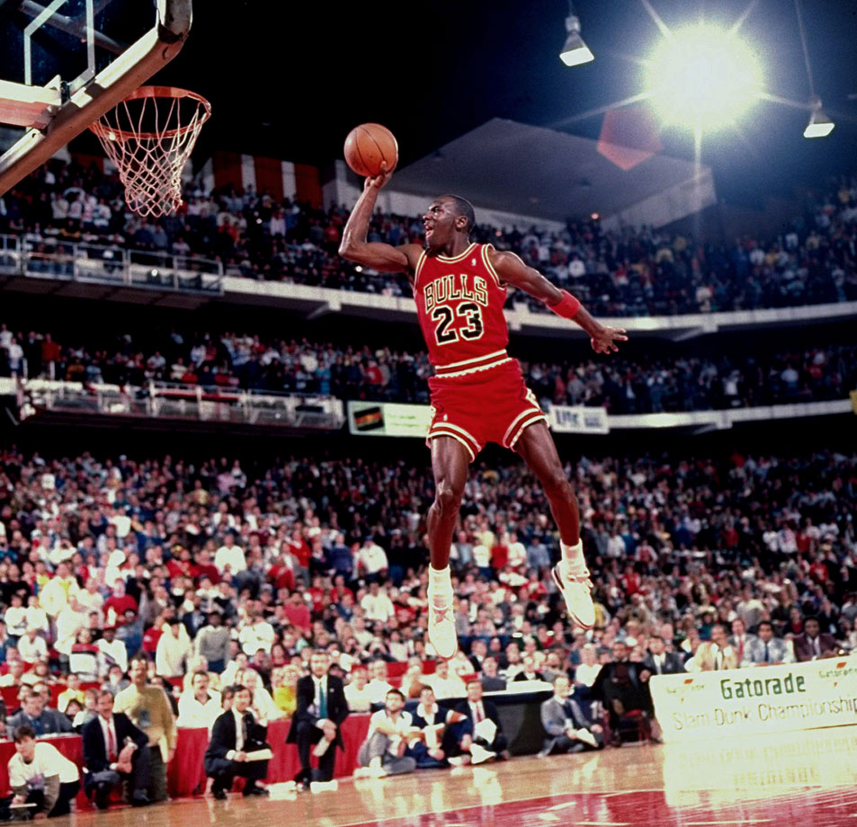 Michael Jordan takes off from the free-throw line to earn a perfect score and win the 1988 Slam Dunk Contest. Jordan's famous jam pushed him in front of Dominique Wilkins for his second straight win.