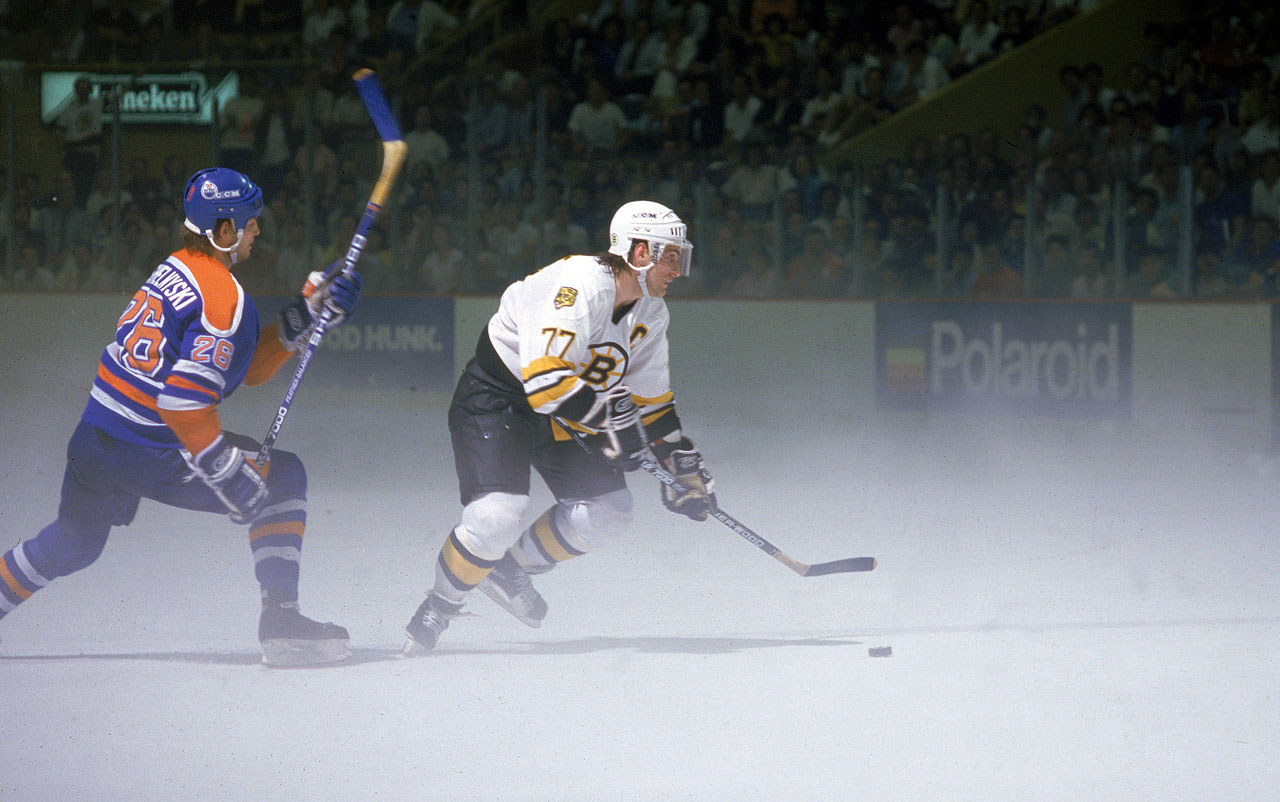 The great Bruins defenseman Ray Bourque, pursued by Edmonton's Mike Krushelnyski, skated the puck through a fog created by an overly warm Boston Garden in which the temperature reached 80 degrees. Game 4 was ultimately postponed due to a power failure in the arena midway through the second period.