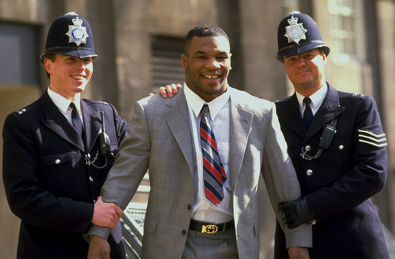 Metropolitan police collar Mike Tyson on a visit to London.