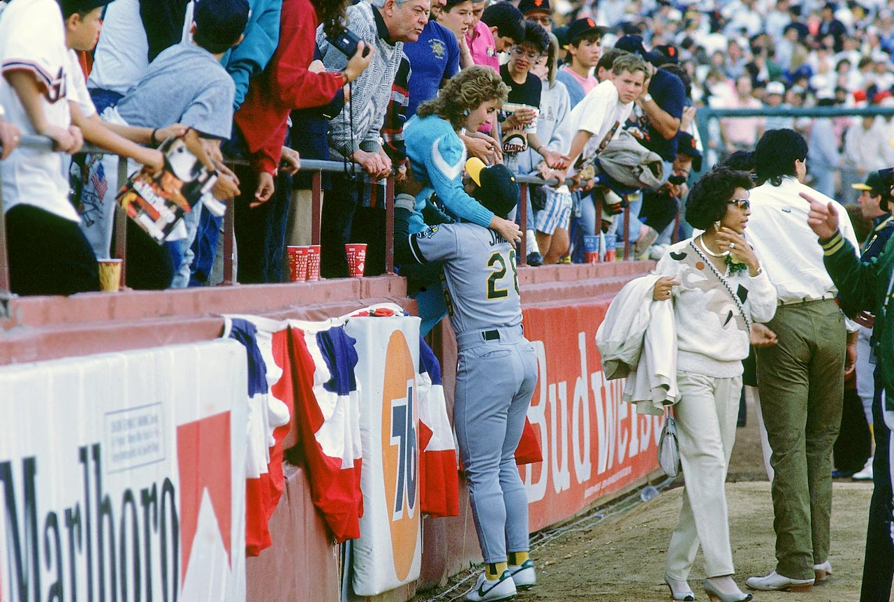 Stan Javier of the Oakland A's helps his wife Veva out of the stands at Candlestick Park after the earthquake.