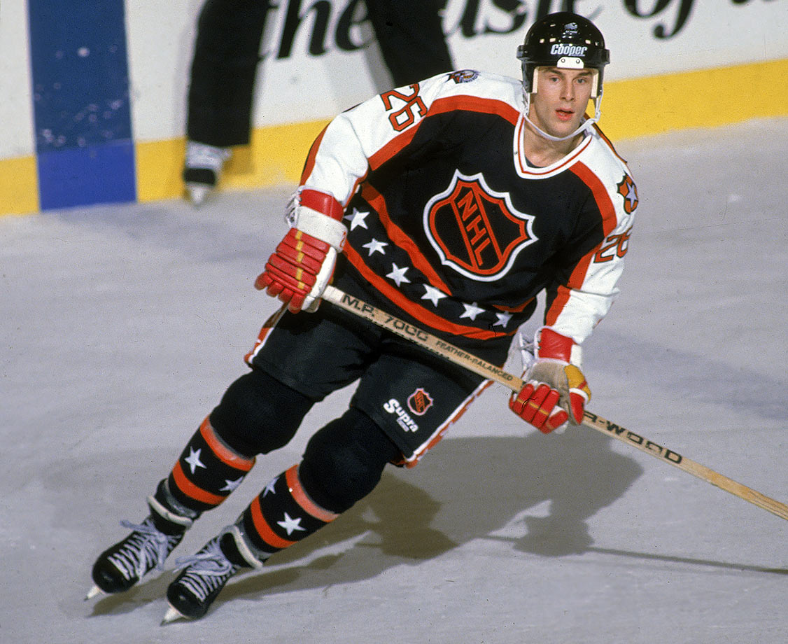 "The NHL ditched the league orange base for the ""visiting"" team after 15 years and went with black, creating a more dramatic appearance. The star-studded trim and the orange and white accents were perfectly proportioned, creating the classic look"