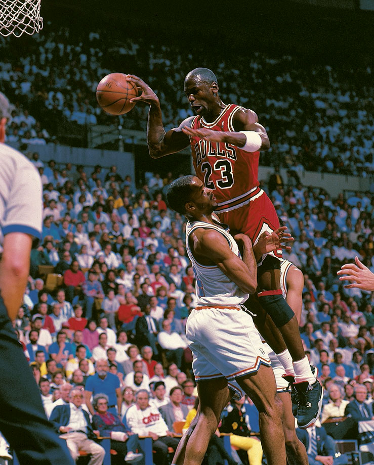 Michael Jordan makes a pass in the face of Cleveland's Ron Harper in Game 5 of a first-round Eastern Conference series. Jordan finished the game with his famous jumper over Craig Ehlo at the buzzer to win the series.