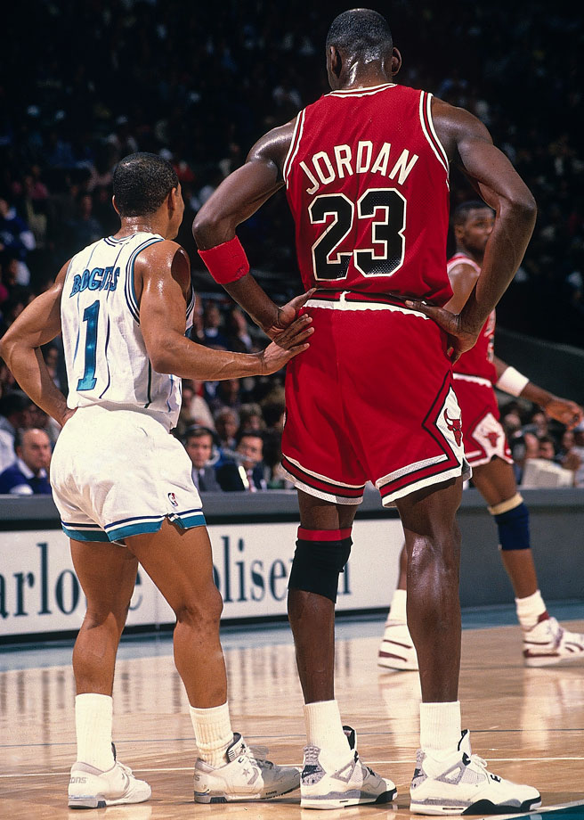 5-3 Muggsy Bogues stands alongside 6-6 Michael Jordan during a game between the Chicago Bulls and Charlotte Hornets in February 1989.