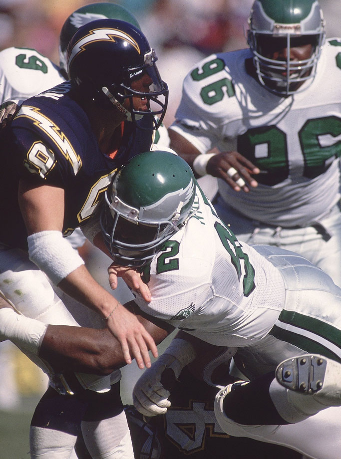 Philadelphia Eagles DE Reggie White hits San Diego Chargers QB Jim McMahon on Nov. 5, 1989 in San Diego, Calif.