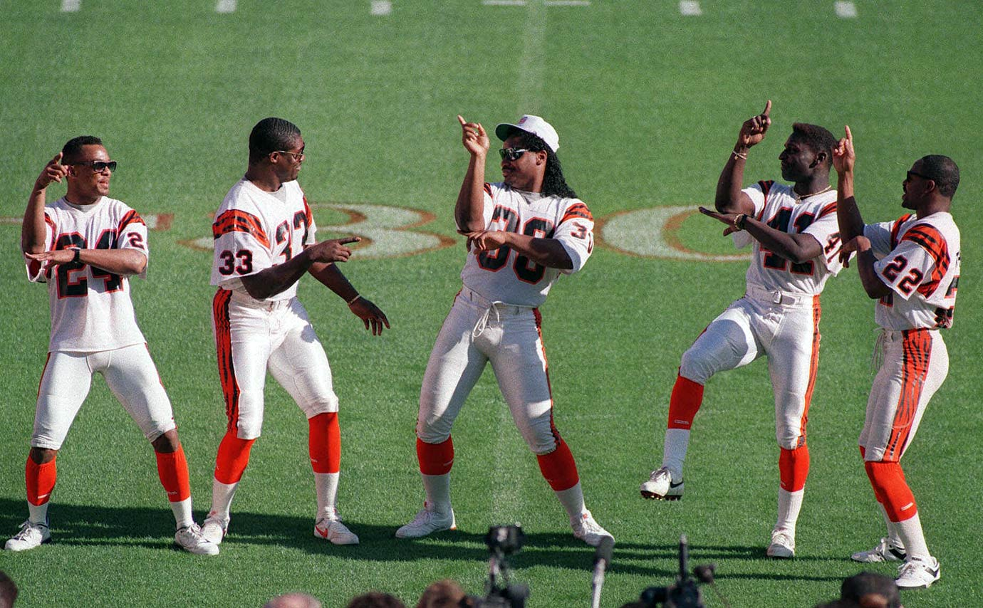 Ickey Woods (center) shows off his famous dance to reporters as his teammates join in on the fun. Woods ran for 79 yards in a 20-16 loss to the 49ers in Super Bowl XXIII.