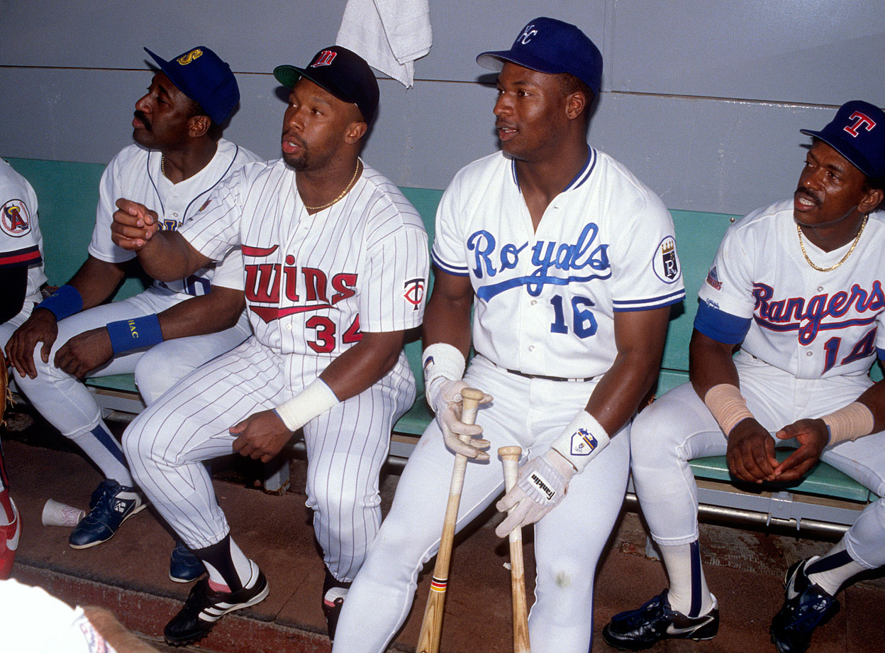 Kirby Puckett and Bo Jackson sit in the dugout before the All-Star game at Anaheim Stadium.