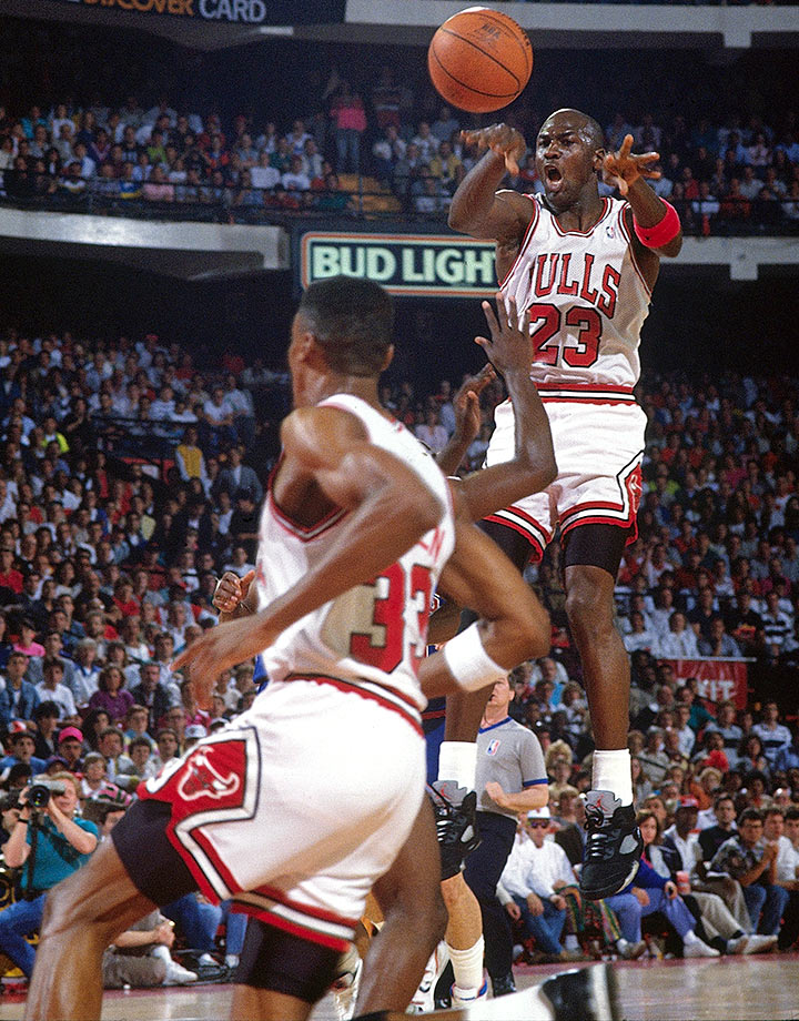 Michael Jordan makes a midair pass to Scottie Pippen against the Detroit Pistons in Game 3 of the 1990 Eastern Conference Finals. Jordan's 47 points and 10 rebounds got the Bulls the win in that game, but the Pistons took the series in seven games.