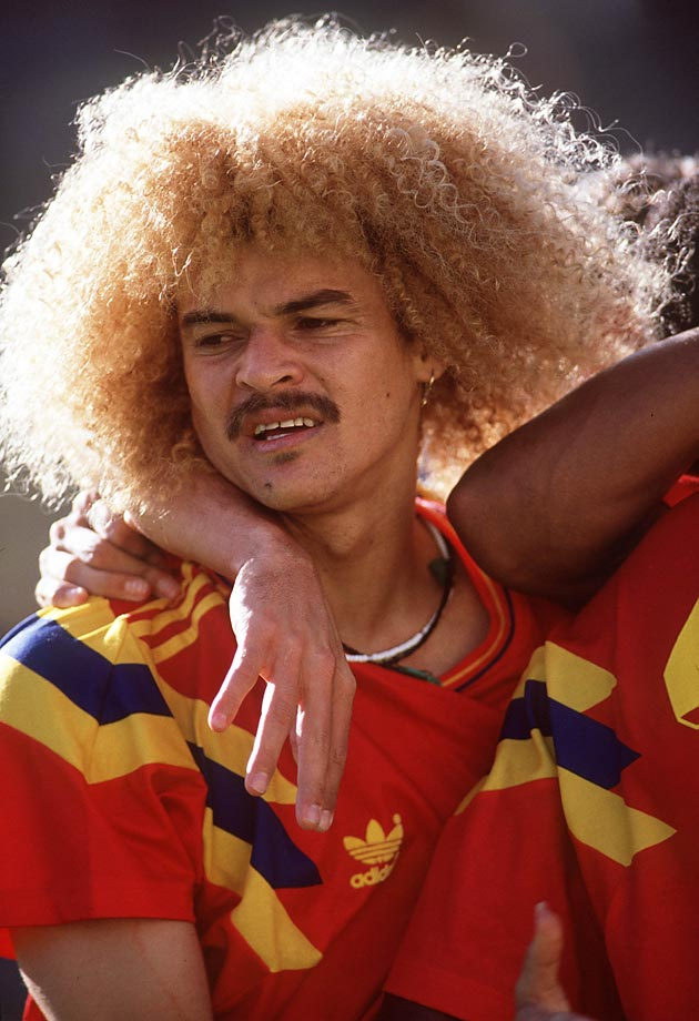 Colombian Carlos Valderrama dazzles the 1990 World Cup with his head of curly, blond hair.