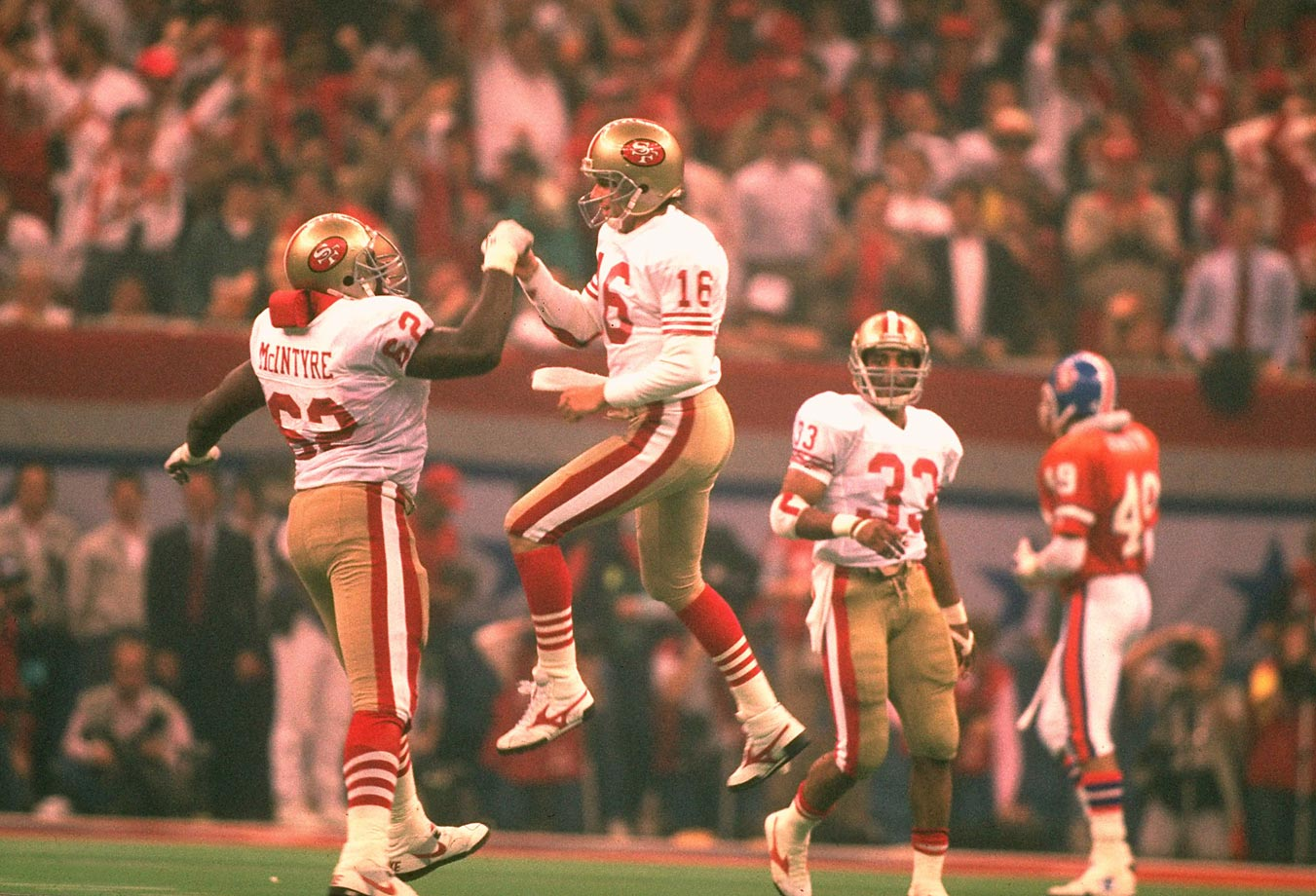 San Francisco quarterback Joe Montana and Guy McIntyre celebrate during their 45 point win over Denver -- the most lopsided in Super Bowl history.