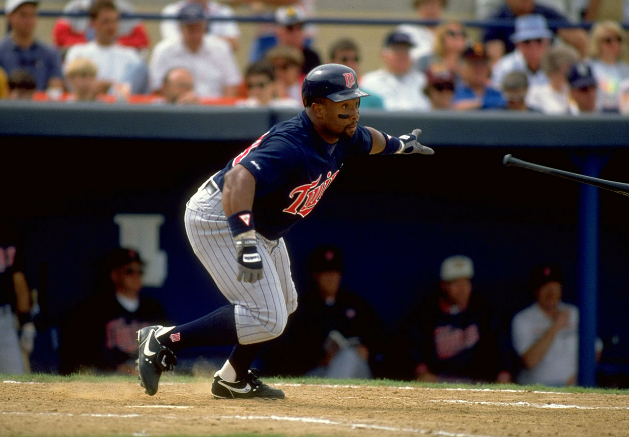 Kirby Puckett tosses his bat during a spring training game in Florida.